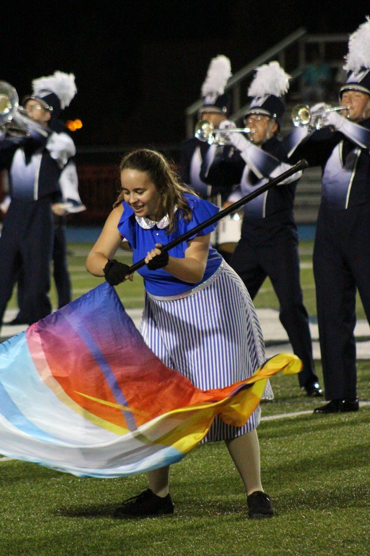 Chloe Painter waves her flag during the 2018-2019 season