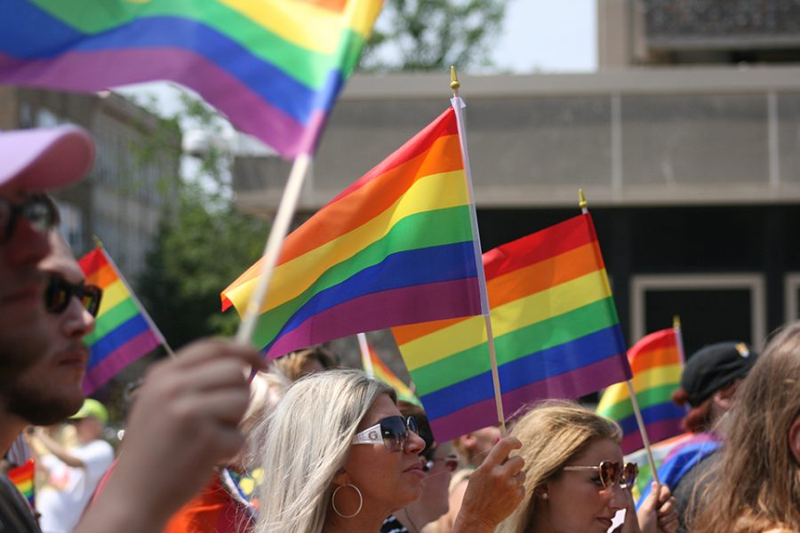 Members of the LGBTQ community wave the rainbow flag at Erie's Pride Festival on June 29. The flag is a symbol of the rights currently being debated in the Supreme Court
