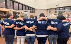 Co-workers of Kuzma painted her name in memorial on the back of Courage Cup T-shirts to honor her at the football game on Oct. 4