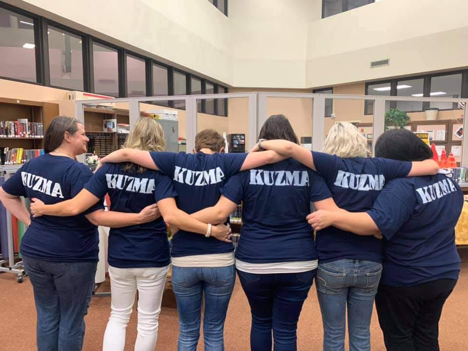 Co-workers+of+Kuzma+painted+her+name+in+memorial+on+the+back+of+Courage+Cup+T-shirts+to+honor+her+at+the+football+game+on+Oct.+4
