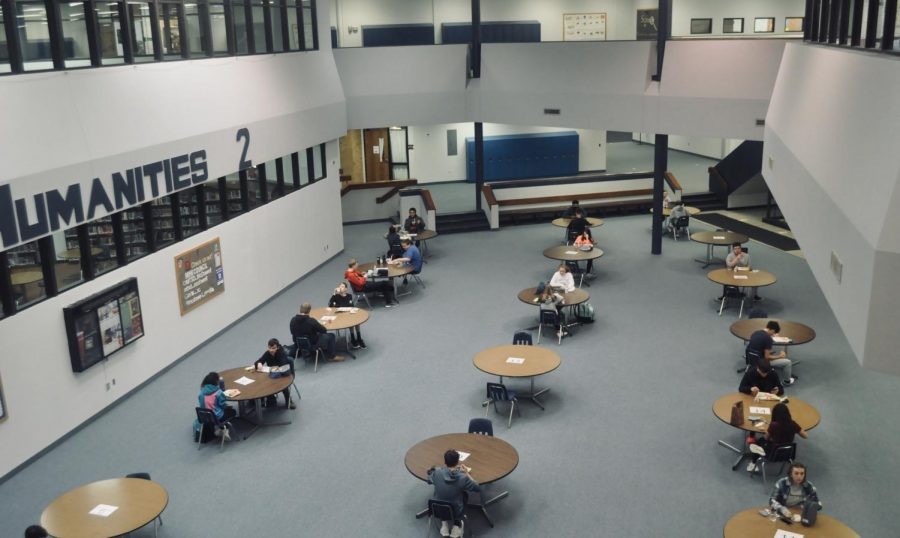 This is 2nd lunch in the humanities area. Students are only to sit two people at a table. Tables have to be spread out and the students at the tables. There are only allowed so many people in the cafeteria at once. They made each lunch have the same amount of students at a time.